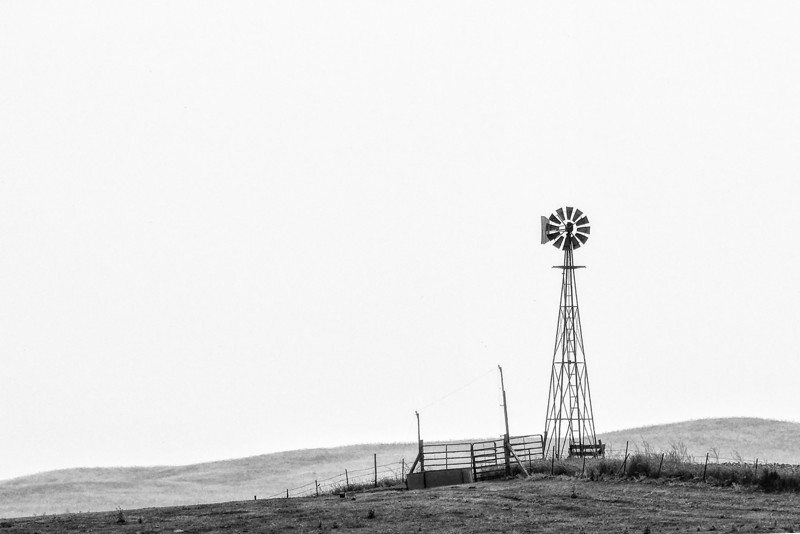 Windmill<br /> Friday started off with a trip to Minot and along the way I ran across this windmill. The humidity is so high right now that landscape pictures are tough to take as everything is like in a fog in the distance.