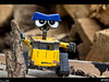 Wall-e<br /> Wall-e was outside inspecting the wood pile for the upcoming winter season. He's also sporting his hard helmet he made out of a Tums bottle. I told him it makes him look more like a rapper than anything.