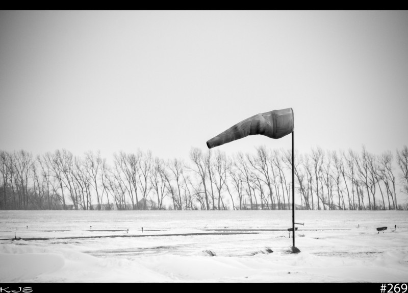 Windsock<br /> It's a lonely job, but someone has to do it.  The windsock at the local airport stays at his post day in and day out.