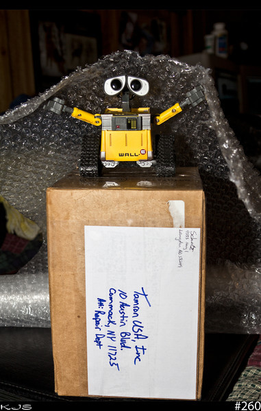 Wall-e<br /> Wall-e says he wrapped the lens up really good. I think Wall-e likes bubble wrap way too much. Hopefully the lens will be returning home quickly.