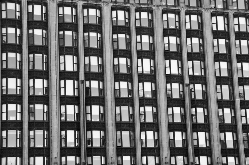 Day 64. September 10, 2010. A large bay of bay windows that a friend and I would later discover to be the dorms for Emerson College. Seriously, what other university can boast a view overlooking Boston Common? Oh, right. Suffolk University next door.<br /> <br /> EF-S 17-55mm f/2.8IS @ 54mm f/5.6. 1/200s. ISO 250.