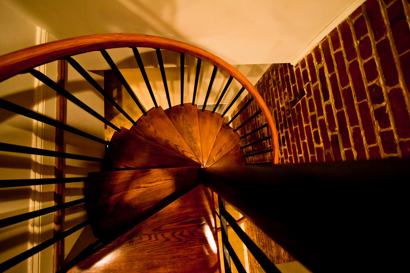 Day 62. September 8, 2010. The friend's house I stayed at in DC had a circular staircase. Rumor has it that the house was originally meant as two separate units, but, as a last minute decision, the two units were combined by this staircase. I had to handhold this since I couldn't figure out any makeshift support to hold the camera over the staircase. Eventually I just leaned over the stairs at a dangerous angle, took a blind shot, reviewed it, and repeated until I had the composition I wanted.<br /> <br /> EF-S 10-22mm f/3.5-4.5 @ 10mm f/3.5. 1/30s. ISO 1000.