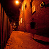 Day 59. September 5, 2010. (Where the streets have no name?) Alley next to the friend's house I'm staying at in DC. So many houses here have brick exteriors, which makes for amazing night scenes. Pretty straightforward shot. Only tricky part was balancing the ISO with the shutter speed to get just enough blur on myself.<br /> <br /> EF-S 10-22mm f/3.5-4.5 @ 10mm, f/3.5. 0.6s. ISO 400.