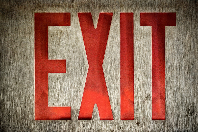Sign<br /> Sunday was another 12 hour shift so a picture of the exit sign at work grunged up is the best I could come up with for my daily photo.