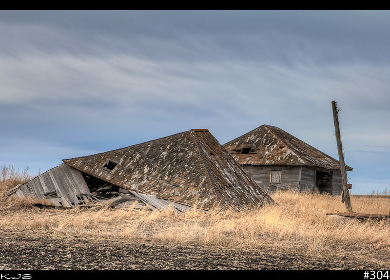 Once Was<br /> At one time there must of been a farm here. The house is completely gone and these tired old buildings are very well weathered.