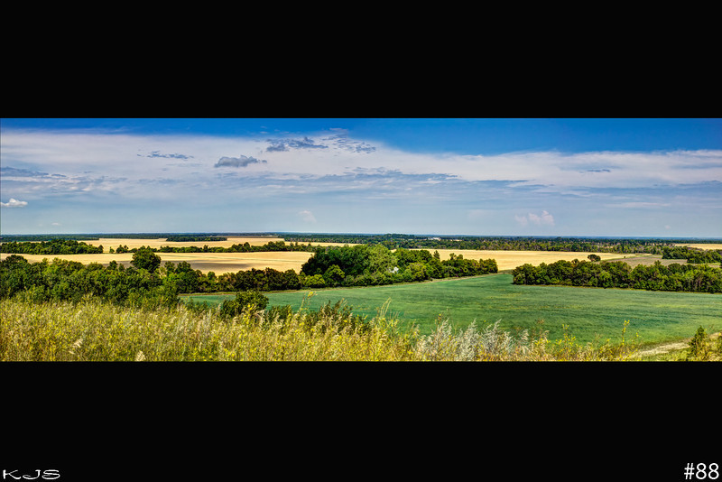 Red River Valley<br /> The Valley is turning golden, gonna be harvest mode shortly for them.<br /> 3 shot pano consisting of 9 images, merged with photomatix and photoshop with natural looking processing.