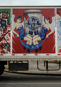 1215 symmetry  The PBR ad on the side of this beer truck is an example of symmetry.