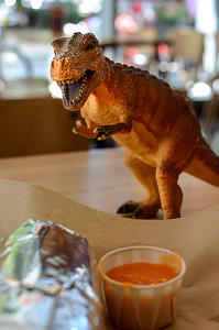 1207 primitive   Laughing Planet Cafe has dinosaurs that roam the table tops.  I usually get the habanero hot sauce to keep them away from my burritos.