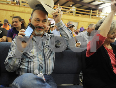 photo by Sarah A. Miller/Tyler Morning Telegraph  Robert Welch of the band Branded pulls up a Bible verse on his cell phone as the pastor asks the congregation to raise their Bibles during the church service Sunday April 26, 2015 at Trail to Christ Cowboy Church in Jacksonville.