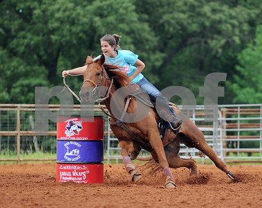 """photo by Sarah A. Miller/Tyler Morning Telegraph  Sarah Berry of Chandler rides her horse Dodger around a barrel during the Race for the Cross ... Because He Paid Your Fees Open 5D Barrel Race Sunday at Trail to Christ Cowboy Church in Jacksonville. The free event had 327 entries with each participant allowed two entries. """"We come from a western heritage and cowboy culture. We want to use what God's given us to help reach people for Jesus,"""" said pastor Mark Norman. Barrel racers were required to attend the 10:30 church service before competing."""
