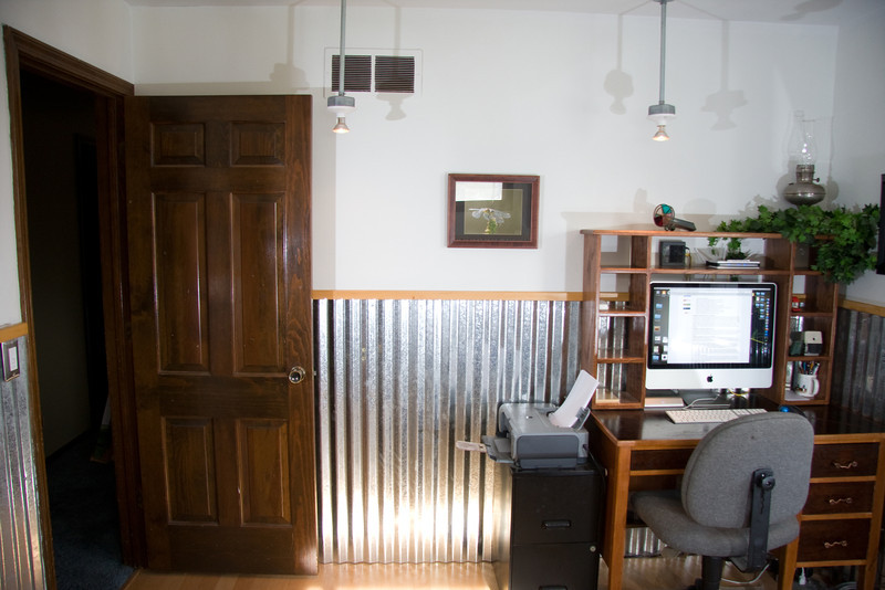 2nd upstairs bedroom with hardwood flooring and tin wainscoting and drop lighting installed in 2010.  Currently an office
