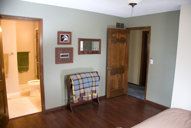Master bedroom with hardwood flooring installed in 2010 with a large closet and private 3/4 bath off of it.