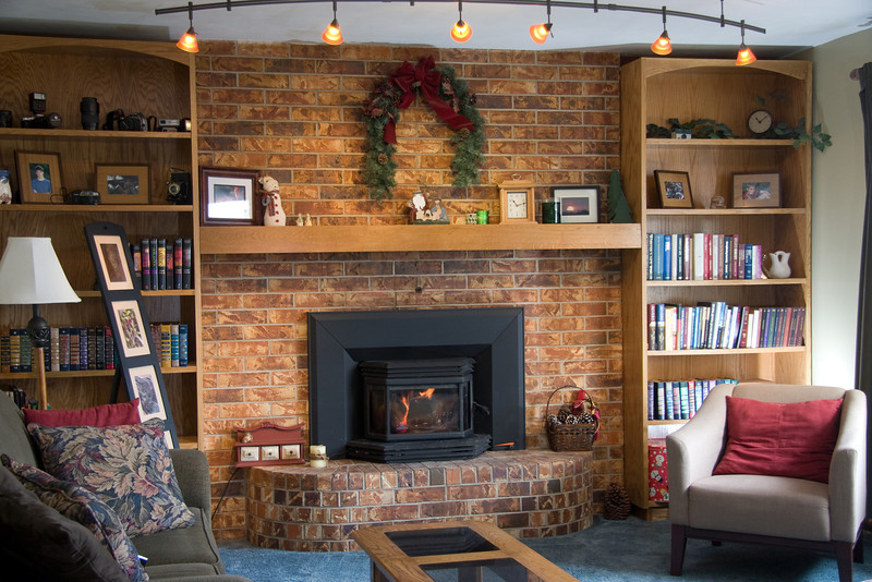 Living room with fireplace insert and custom bookshelves and mantel.<br /> NOTE:  Bookshelves are handmade by our oldest son in the Silver Lake wood shop and could be sold under a separate agreement.