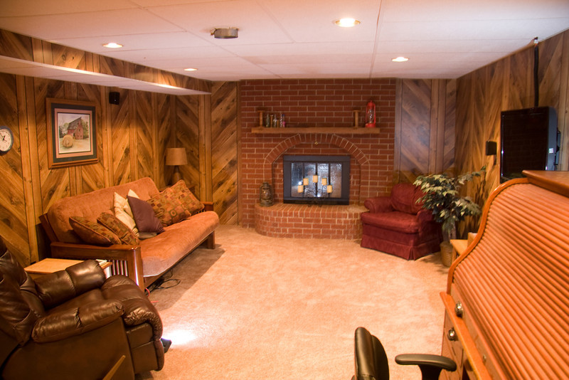 Basement family room with fireplace and carpet installed in 2011.  Stairs to main floor are on the left of this picture, behind the sofa and wall.