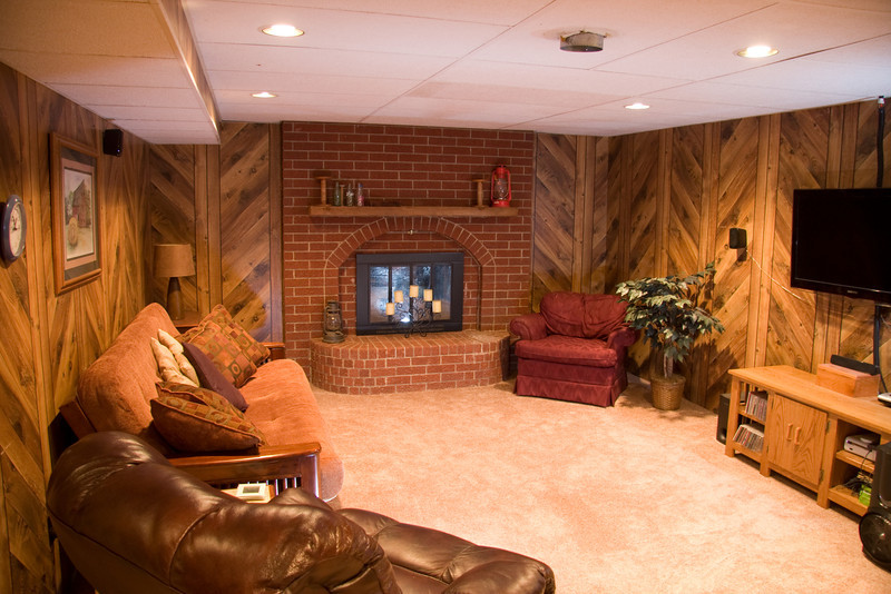 Basement family room with fireplace and carpet installed in 2011.  Stairs to main floor are on the left of this picture.