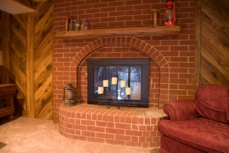 Basement fire place, with chimney cleaned in 2011 and approved for general fire use.
