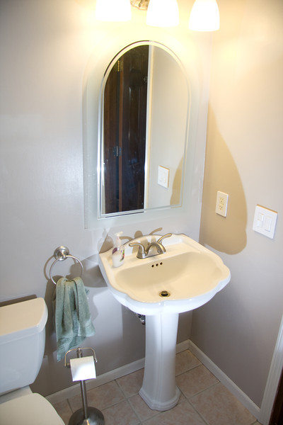 Master bath with shower and linen closet and vanity.