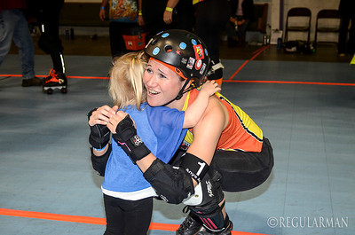 1117 sentiment  The daughter of one of the winning skaters had big hugs for members of the losing team.