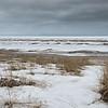 35 Barren.  Lake Huron just before the spring thaw.  In summer this is Bluewater Country and the beaches are busy but at this time of the year it still has that wintery desert look - not a soul around and a nice strip of sand for the dog to run!