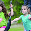 Evelyn Roland, 5, gives her younger sister Violet, 3, a boost on the swings at Coolidge Park in Fitchburg on Tuesday afternoon. SENTINEL & ENTERPRISE / Ashley Green