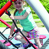 Evelyn Roland, 5, climbs on the jungle gym at Coolidge Park in Fitchburg on Tuesday afternoon. SENTINEL & ENTERPRISE / Ashley Green