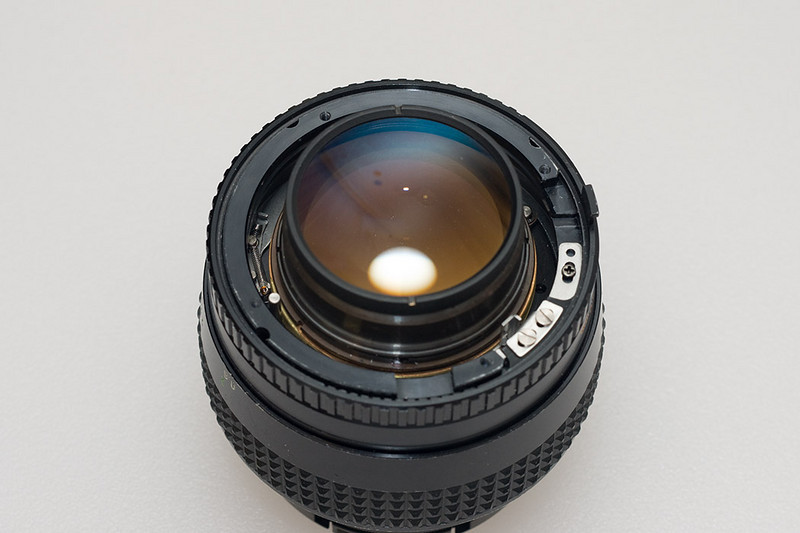 Lens with old mount removed along with the aperture linkage which is attached to the mount assembly.