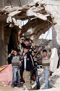Bethlehem, Palestine Children stand in front of a home destroyed by the Israeli military. Three Palestinians were shot by snipers as they retaliated by throwing rocks at the tank - Two youth were killed, one elderly woman was critically injured with trauma to the brain.