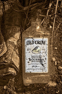 2013-10-20. O is for Old Crow.  Found this empty bottle with an Old newspaper on the side of the road.  Thank you for your comments on my feather pano yesterday.