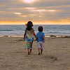 """2015-01-05. Sister and Brother<br /> Maia and Noah at La Jolla Beach, San Diego, CA<br /> This is a reprocessed shot, to try and enhance the sky without overdoing it.<br /> Thanks so much for your kind words and encouragement to keep shooting.<br /> Karen<br /> <br /> The original is here:<br /> <a href=""""http://kjakes1.smugmug.com/organize/Travel/San-Diego-3-Aug-2014/i-TDJVQVk"""">http://kjakes1.smugmug.com/organize/Travel/San-Diego-3-Aug-2014/i-TDJVQVk</a><br /> Thank you arctangent for the heads up on the broken link.<br /> Steve's Digicams POTD for Nov. 23, 2014"""