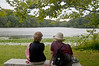 Rockefeller State Park in New York on an overcast dreary Labor Day, 2012, was just the place for a walk in the woods around this lake. These two ladies were viewing the lake and the white water lilies in full bloom and chatting.