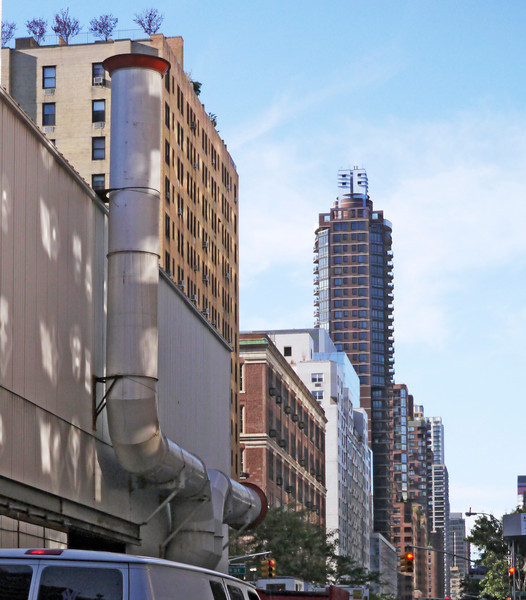 Walking along Second Avenue, NYC, one is struck with the parallel of this ventilation stack of the subway construction site with the tall apartment house beyond it. All the vertical patterns are what made me interested in this view. (9-20-12)