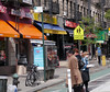 In one block, one has orange, purple, blue, yellow, red, and green colors in the awnings and signs of the small stores. One may not normally think that the Upper East Side of Manhattan is so colorful. (10-17-12)