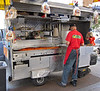 Lunch carts are also ubiquitous around employers of many workers from mid-morning until mid-afternoon. At 11:30, lunch is being cooked for all who want it. (9-13-12)