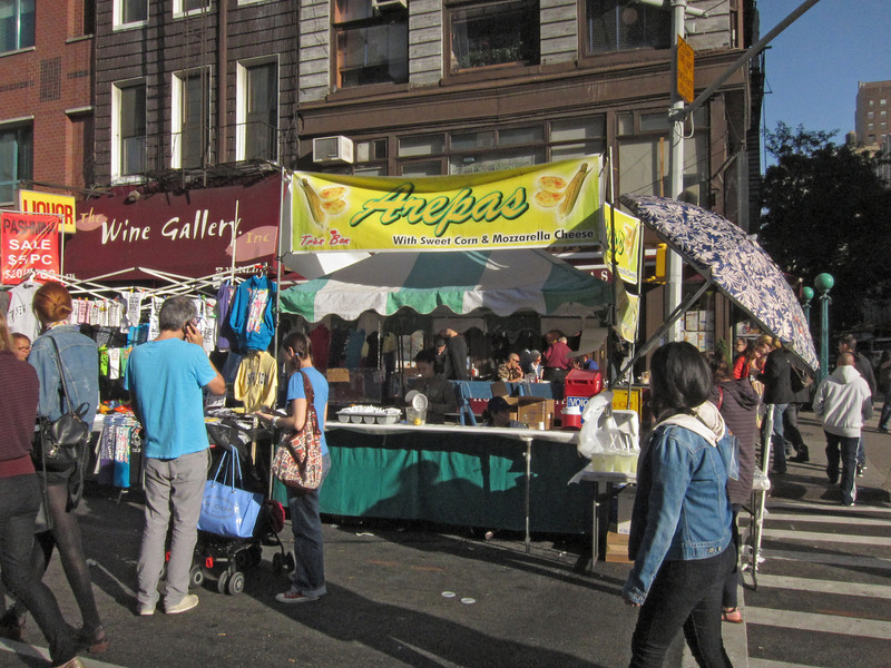 Saturdays in warm weather are often street fair days.The booths selling street food are almost continuous along the street. (10-21-12)