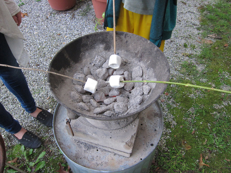 The grandchildren visited on a crisp Fall day  so we grilled hot dogs and roasted marshmallows for dinner. The aluminum coal pot is 52 yeas old and uses charcoal. It stays where is is in the yard all year round. (9-15-12)
