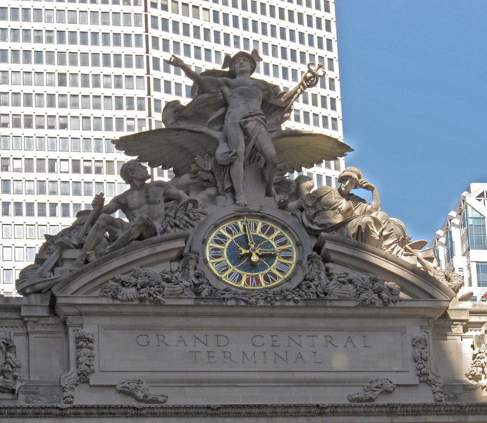 At just the right time of day in the winter, the sun shines up the street directly on this south wall of Grand Central Terminal with its iconic carving. (9-25-12)