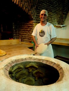 Bread making with the traditional toné, or bread oven.
