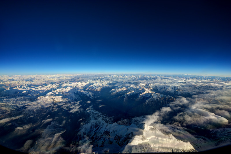 Over the Himalaya between waypoints Purpa and Hotan. Metric flightlevel 11900M (39100 feet) in Chinese airspace. Highest mountains on this airway: 26000 feet. View from the cockpit of an Airbus A380.
