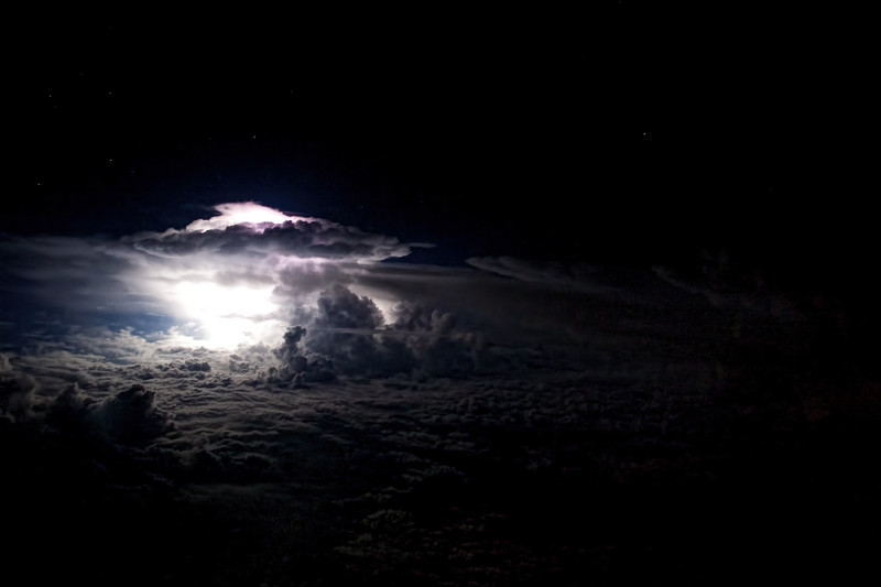 Cockpit view of a thunderstorm over the Indian Ocean at 36000 feet. Sydney to Dubai. Airbus A380. Usually the window shades in the cabin are all closed this time a night. The few passengers that are awake watch movies and are missing out on the fantastic light show that goes on over the equator every night.