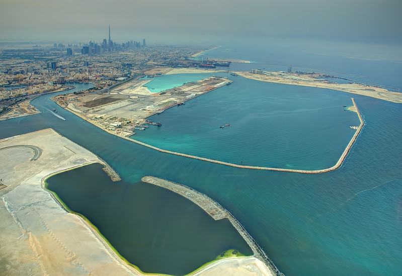 Port Rashid and downtown Dubai with the world's tallest building, Burj Khalifa in the background.