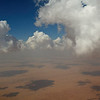 Clouds over the desert approaching Dubai from Oman. Airbus A380 cockpit view.
