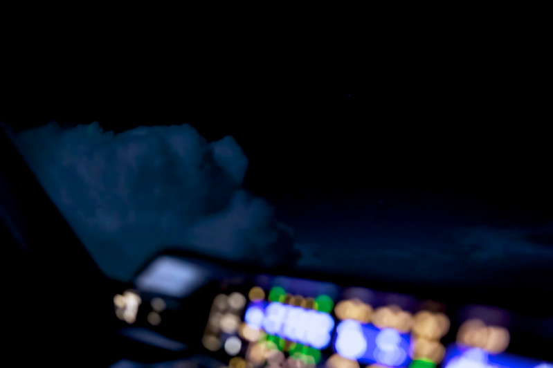 Top of a thunderstorm over the Maledives, cruising at 40000'. Airbus A380 cockpit view.