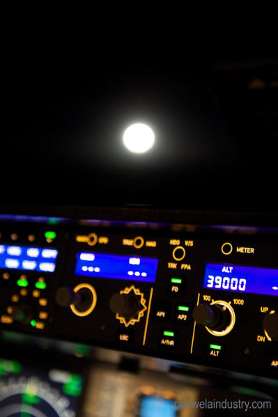 Full moon as seen from the cockpit at 39000 feet over the Indian Ocean. Airbus A380.