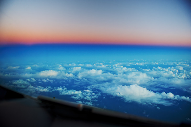 Sunset behind us over the Atlantic Ocean as seen from the cockpit of an Airbus A380.  New York to Dubai. The shadow of the earth is visible in dark blue once the sun sets below the horizon.