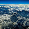 Over the Himalaya, on the way to Beijing. Some of the mountains on this route of flight are up to 26000 feet high.