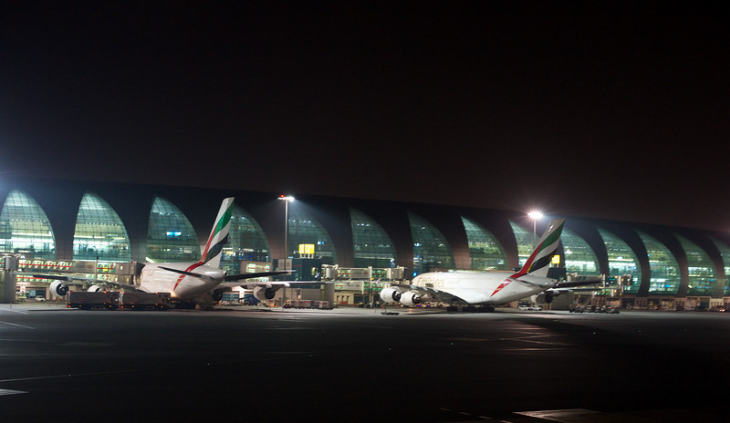 Two Airbus A380's parked at the terminal in Dubai.