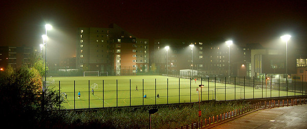"11.11.11 - ""England's Green and Pleasant Land""  Well it's astroturf actually down at the University, but it was about the only real colour on a very dreary and damp evening. I've shot this before, but I liked how the lights were picking up on the mist and light drizzle in the air. I thought you needed a break from light streaks :)"
