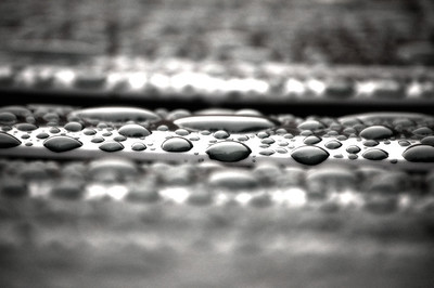 "21.05.13 - Wet  I was woken in the night by heavy rain banging on the window, but at least it gave provided photo opportunity. This is water droplets on a garden sun lounger, with the ""Monday Morning"" filter in Color Efex Pro applied to give a bit more contrast"