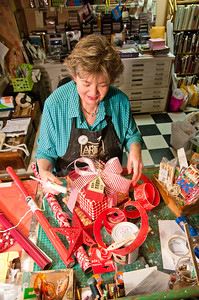 Lynne Perrella wrapping gifts in her studio.