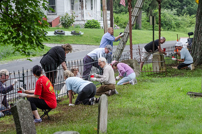 1307_volunteers paint fence_014